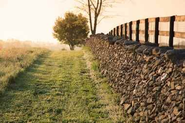 Stacked stone walls and mown grass demark miles of hiking trails at the Goodstone Inn.
