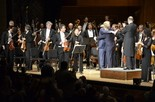 """Composer Jeremy Gill (left) joins soloist Christopher Grimes (center) and Maestro Stuart Malina (right) on stage after the Harrisburg Symphony Orchestra's world premiere performance of his """"Notturno Concertante."""""""