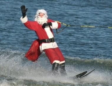 Santa waterskiis into Alexandria on Christmas Eve.