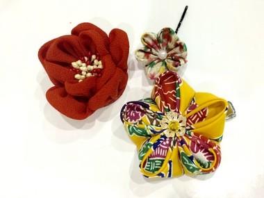 Kanzashi (hair ornamental pins) made by Kuniko Kanawa on sale at Zenkaikon 2015 in downtown Lancaster.