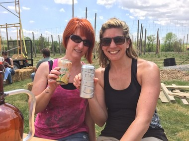 Local beer writers Chelsie Markel and Sara Bozich enjoy post-farming libations, thanks to Troegs Brewing Company.