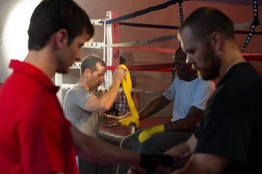 James Adams helps Danny Glover prepare for a boxing scene. Photo provided by Adams.