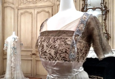 """This evening gown is one of Adelaide Frick's garments on display in the """"Lace and Luxury"""" exhibit at The Frick Pittsburgh."""