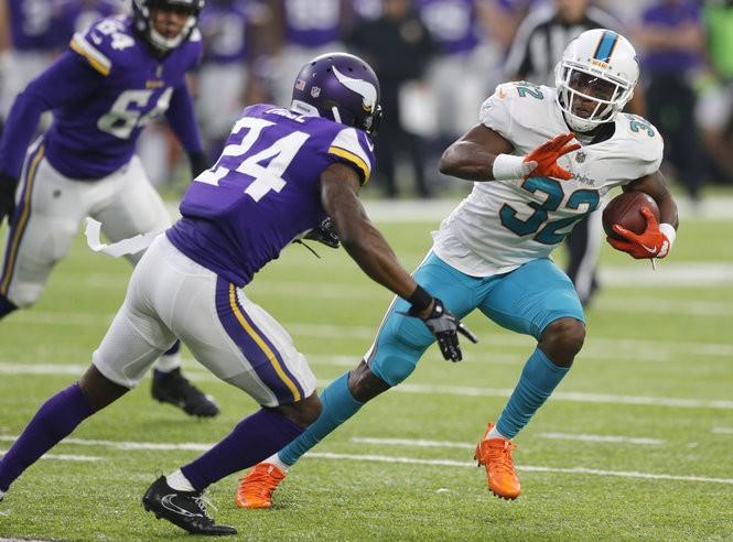 a362a1574 Miami Dolphins running back Kenyan Drake (32) runs from Minnesota Vikings  cornerback Jabari Price (24) during the first half of an NFL preseason  football ...
