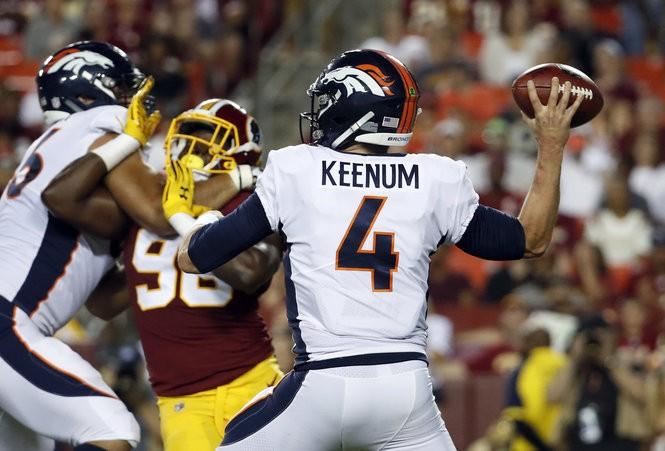 3e8864f0cf7 Denver Broncos quarterback Case Keenum (4) passes the ball during the first  half of a preseason NFL football game against the Washington Redskins,  Friday, ...