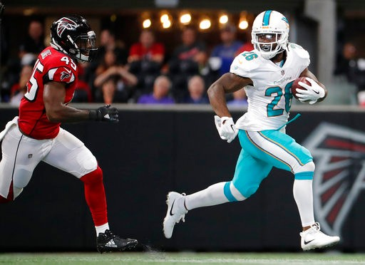 681446506 Miami Dolphins running back Damien Williams (26) runs as Atlanta Falcons  middle linebacker Deion Jones (45) defends during the first half of an NFL  football ...