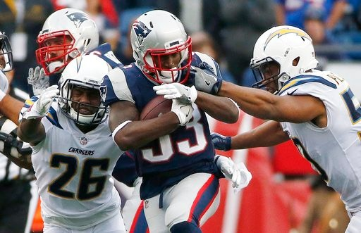 2645036c4 New England Patriots running back Dion Lewis carries the ball against Los  Angeles Chargers cornerback Casey Hayward (26) and inside linebacker Hayes  Pullard ...