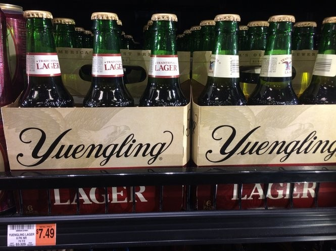 How do six-pack beer prices compare at Sheetz, Wegmans
