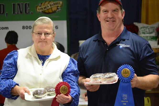 First-place winner Jim Harper of Centre County, right, and second-place winner, Darlene Noll, of Schuylkill County, left, in Pennsylvania's Greatest Whoopie Pie Contest.