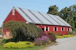 Threefold Farm's goat barn is landscaped with colorful flowers.