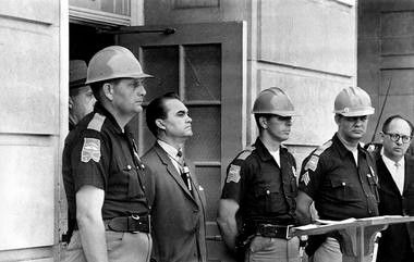 Gov. George C. Wallace blocks the entrance to the University of Alabama as he turned back a federal officer attempting to enroll two black students at the university campus in Tuscaloosa, Ala., on June 11, 1963. (The Associated Press, file)