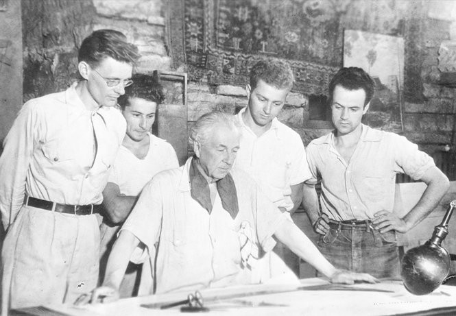 Architect Frank Lloyd Wright, center, is surrounded by apprentices at Taliesin, his estate at Spring Green, Wis., Aug. 17, 1938.