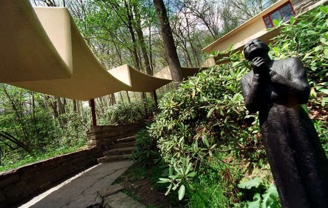 A cantilevered walkway leads to the guest house at Fallingwater.