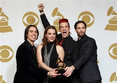 "Members of Halestorm, from left, Joe Hottinger, Lzzy Hale, Arejay Hale, Josh Smith pose backstage for the best rock album award for ""Love Bites (So Do I)"" at the 55th annual Grammy Awards on Sunday, Feb. 10, 2013, in Los Angeles. (Photo by Matt Sayles/Invision/AP)"