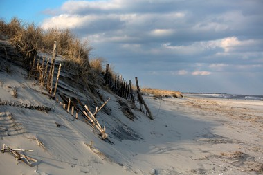 The sand dunes at Stone Harbor, NJ kept the town from being hit harder from Hurricane Sandy storms last Oct. but ongoing work on the beaches and businesses appear to be getting the town ready for the coming tourist season after flooding did hit the town. Mark Pynes | mpynes@pennlive.com