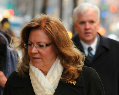 Suspended Pennsylvania Supreme Court Judge Joan Orie Melvin turns to enter the Allegheny County Courthouse, Wednesday, Jan. 23, 2013 in Pittsburgh. (AP Photo/Pittsburgh Post-Gazette,Darrell Sapp)