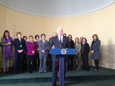Gov. Tom Corbett stands with domestic violence services advocates today in making a pitch for his proposed 10 percent increase in state funding to combat this societal problem.