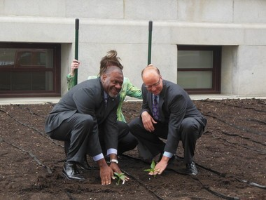 Following today's ceremonial groundbreaking, Rep. Jake Wheatley, D-Allegheny, (at left) and Sen. Mike Brubaker, R-Lancaster County, go outside and actually plant the first plants in the Capitol Hunger Garden.
