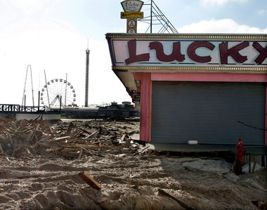 In this Thursday, Nov. 22, 2012, file photograph, debris left by Superstorm Sandy lay where the boardwalk had been in front of Lucky Leo's arcade in Seaside Heights, N.J. (AP Photo/Mel Evans, File)