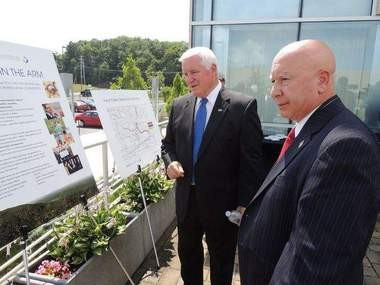 Gov. Tom Corbett, left, and state Rep. Mario Scavello, R-Monroe County, last week reviewed a $5 million plan to extend the Route 611 Corridor Natural Gas Line.