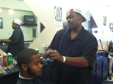 Tyer Richardson, a barber at Gifted Hands Barber Studio in midtown Harrisburg is hopeful the debt deal will usher in economic prosperity for his city. Richardson is hopeful more customers - like Kodi Flanagan - will return to the shop.