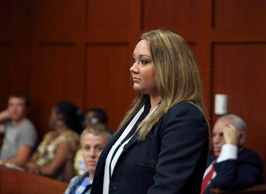 Shellie Zimmerman, wife of George Zimmerman, appears at the Seminole County Courthouse in Sanford, Fla. on Wednesday, Aug. 28, 2013. Shellie Zimmerman pleaded guilty to a misdemeanor perjury charge for lying during a bail hearing after her husband's arrest, and she was sentenced to a year's probation and 100 hours of community service. (AP Photo/Orlando Sentinel, Gary W. Green, Pool)
