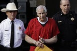 FILE - In this Oct. 9, 2012 file photo, former Penn State University assistant football coach Jerry Sandusky, center, is taken from the Centre County Courthouse by Centre County Sheriff Denny Nau, left, and a deputy, after being sentenced in Bellefonte, Pa. (AP Photo/Matt Rourke, File)