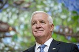 Gov. Tom Corbett has signed new child-protection bills into law.