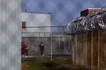 Inmates walk around the yard at the State Correctional Institution at Camp Hill. JOHN C. WHITEHEAD/The Patriot-News