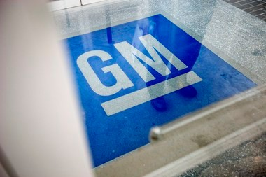 The logo for General Motors decorates the entrance at the site of a GM information technology center Jan. 10, 2013, in Roswell, Ga. (AP Photo/David Goldman, File)