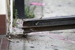 A bolt from a fallen security door outside a Rita's Water Ice store is seen in the Brewerytown section of Philadelphia on Saturday, June 28, 2014. Investigators tell Philly.com that the metal security door detached and fell on a 3-year-old girl who died. (AP Photo/ Joseph Kaczmarek)