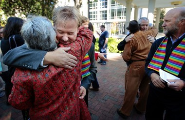 Rev. Frank Schaefer, second from left, gathers with supporters from the Methodist church and the gay, lesbian and transgender community for a prayer service before a hearing by the United Methodist Judicial Council Wednesday, Oct. 22, 2014, in Memphis, Tenn. Schaefer was suspended and then defrocked last year following a church trial in southeastern Pennsylvania when he would not promise to uphold the Methodist law book, which bans clergy from performing same-sex marriages. (AP Photo/The Commercial Appeal, Jim Weber)