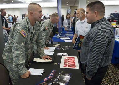 SSG Steve Jones of the National Guard talks with Dale Wintersteen, an Army veteran, of Lancaster during the Hiring Our Heroes veterans job fair in 2013 at the PA State Farm Show Complex & Expo Center. The PA Chamber of Business and Industry and the Harrisburg Regional Chamber & CREDC (Chamber & CREDC) partnered with the U.S. Chamber in hosting the event. Joe Hermitt, PennLive.com