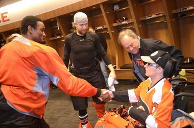 Jackie Lithgow gets to meet his favorite player Wayne Simmonds during a visit to the Philadelphia Flyers training facility.