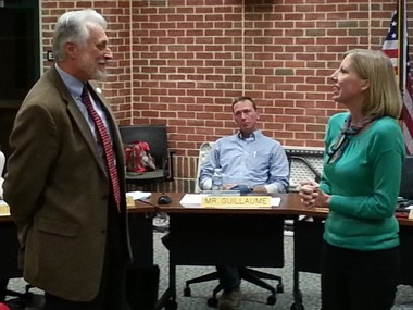 Carlisle Area School Board members, including President Nancy S. Fishman, right, shown in a meeting last yearwith former school board member Tim Potts, approved its tentative budget. Potts told the board he supported the spending plan.