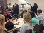 Students gather at tables at a rally held for Medard Kowalski, 17.