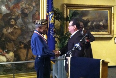 James Howard, chaplain of Ephraim Slaughter American Legion Post 733, is recognized by Jeff Haste, chairman of the Dauphin County commissioners.