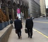 Former Harrisburg City Finance Director Robert Kroboth, right, leaving the Attorney General's office in downtown Pittsburgh Tuesday.