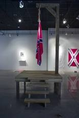 """Artist John Sims exhibit, """"The Proper Way to Hang a Confederate Flag"""" was showcased at Gettysburg College 11 years ago. The art installation was boycotted by the Sons of Confederate Veterans and moved from its outdoor stage. As a result Sims boycotted his own appearance."""