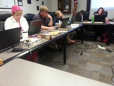 East Pennsboro Area School Board approved a final budget for 2015-16 that will boost taxes 3 percent. Members Nancy Otstot, left, and Anne Alger, not shown, voted against the budget.L-R, Otstot, board member Scott Leiser, board member Lauren Swett, Superintendent Jay Burkhart, board President Melissa Beers.