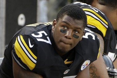 Pittsburgh Steelers linebacker Adrian Robinson (57) sits on the bench during an NFL preseason football game against the New York Giants in Pittsburgh, Saturday, Aug. 10, 2013. The Giants won 18-13. (AP Photo/Gene J. Puskar)