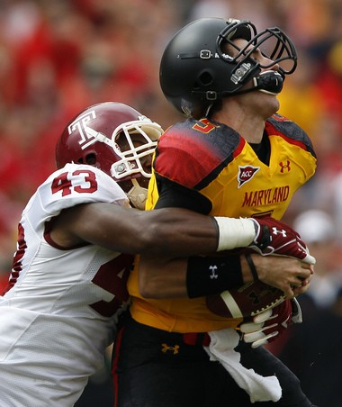 Temple defensive end Adrian Robinson, left, sacks Maryland quarterback Danny O'Brien during the first half of an NCAA football game in College Park, Md., Saturday, Sept. 24, 2011. (AP Photo/Patrick Semansky)
