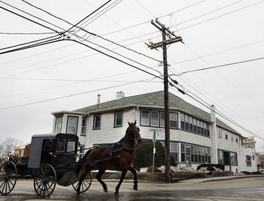 The Amish have made Lancaster County a tourist destination. In this file photo, an Amish buggy rolls through the intersection of Route 896 and Furnace Road in Georgetown Lancaster County.