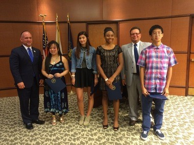 Winners in the 15-18 age group in Dauphin County's cultural diversity essay contest were (left to right): Annalise Koup, first; Ingrid Hrobuchak, second; Jakasia Cabbagestalk, third; Danny Tran, fourth. With them are Dauphin County Commissioners George Hartwick (left) and Jeff Haste. Absent was Matthew Plesco, fifth.