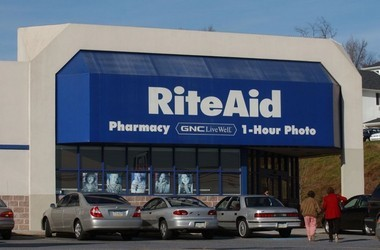 Rite Aid's troubled history of big deals and high debt would continue for some time to come, seemingly digging an even bigger hole for the cash-strapped company. Pictured: Customers walk into a Rite Aid in Camp Hill, Thursday, Dec. 16, 2004.