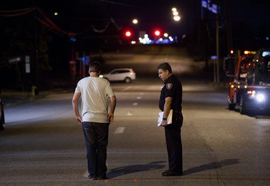 A Harrisburg police officer administers a standard field sobriety test during a traffic stop.