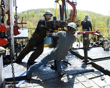 Workers move a section of well casing into place at a Chesapeake Energy natural gas well site near Burlington, Pa., in Bradford County. Some Pennsylvania Democrats worry that natural gas drilling isn't as safe as politicians and lobbyists claim.