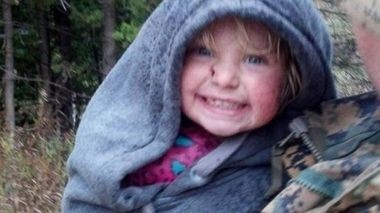 Two-year-old Brooklyn Lynn Lilly was grinning from ear to ear Thursday after being found in the woods 22 hours after she wandered away from her Michigan home.