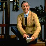 """Fred Rogers poses on the Pittsburgh set of his television show """"Mister Rogers' Neighborhood,"""" in this 1996 publicity photo."""
