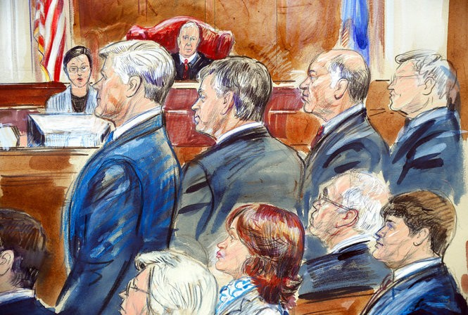 This courtroom sketch shows Paul Manafort, second from left, and members of his defense team including Kevin Downing, standing left, as they listen to verdicts in federal court in Manafort's the bank fraud and tax evasion trial in the courtroom of U.S. District court Judge T.S. Ellis III in Alexandria, Va., Tuesday, Aug. 21, 2018.